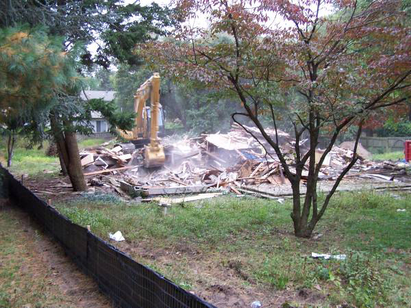 Excavator demolishing a building.