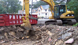 Excavator digging a foundation.